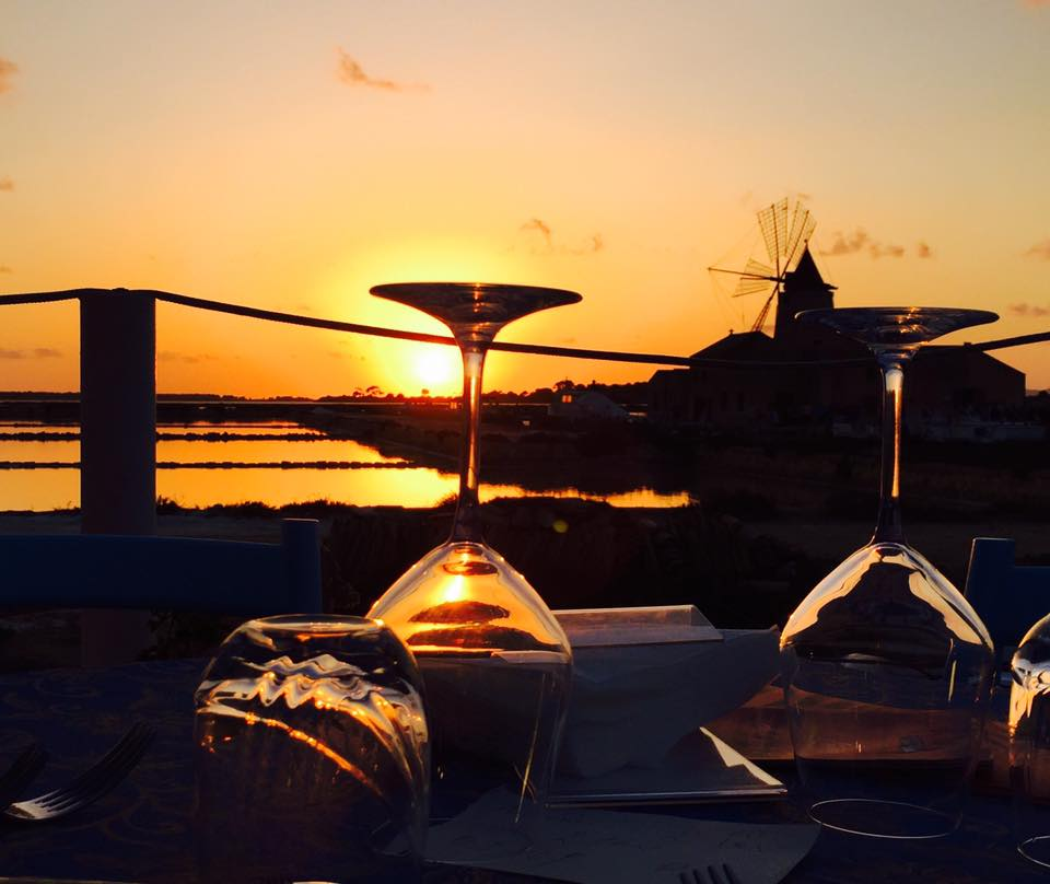 2 glasses of wine on table on sunset