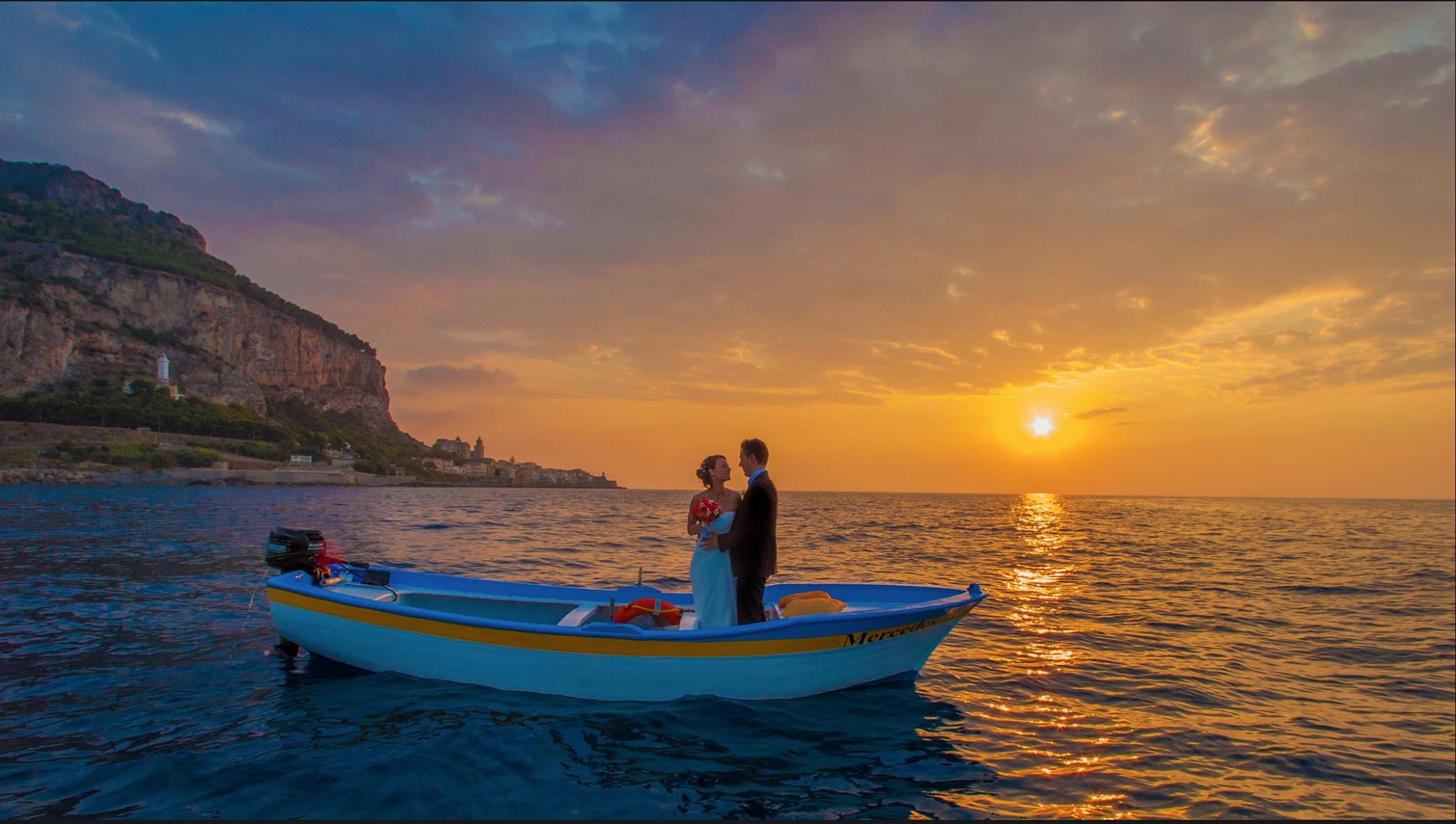 bride and groom in a fisherman boat