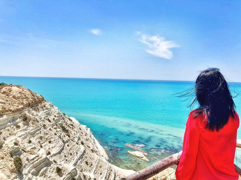 "The ""Scala dei Turchi"" is a splendid, blinding, white jewel that frames the clear blue sea."